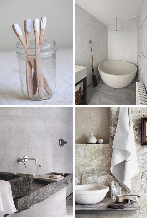 łazienka rustykalna a w niej obowiązkowe elementy które tworzą ten styl: drewniane szczoteczki do zębów, betonowe ściany, surowe wanny i umywalni, jasne barwy
