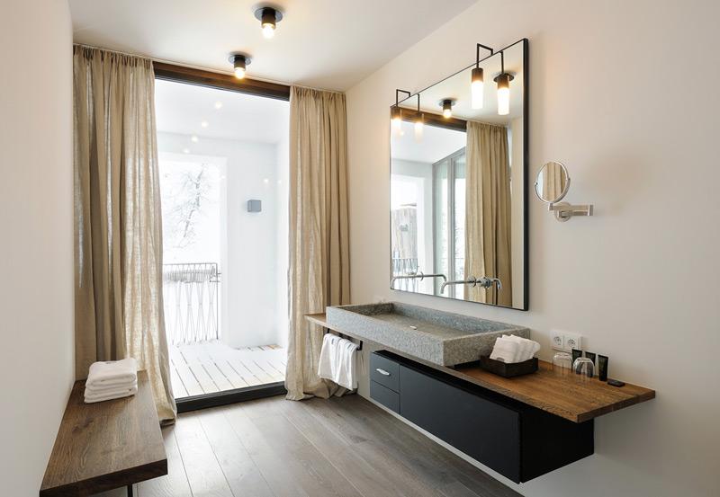 aranżacja łazienki - kamienna umywalka w połączeniu z nowoczesną szafką