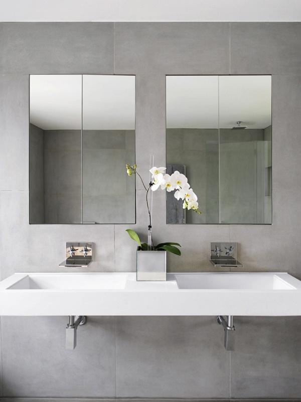 lustro łazienkowe w postaci lustrzanych szafeczek na umywalkami