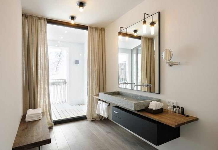 lustro łazienkowe osadzone na płycie meblowej z zamontowanymi bateriami
