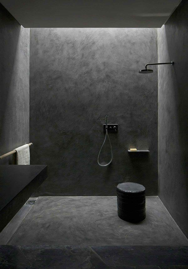 czarna surowa łazienka czarny walcowy pomocnik łązienkowy