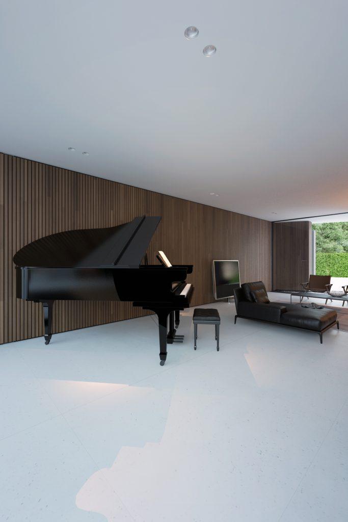 czarny fortepian na tle drewnianej ściany i bardzo przestrzennym salonie w minimalistycznym stylu