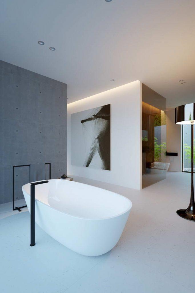 minimalistyczna łazienka z wolnostojącą białą wanną z kontrastującymi nowoczesnymi czarnymi bateriami