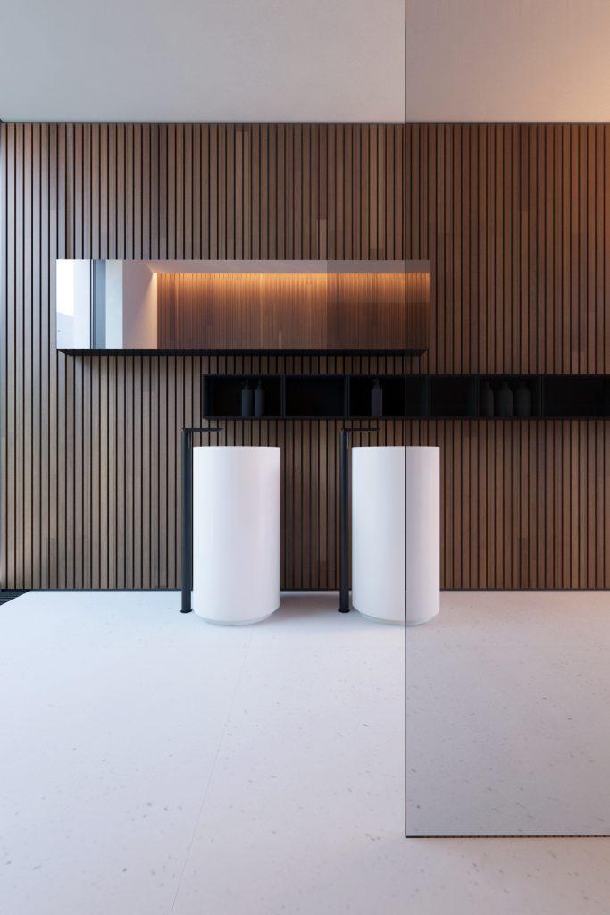 minimalistyczna łazienka a w niej dwie białe, wolnostojące umywalni z osobnymi bateriami na tle drewnianej ściany z minimalistycznym poziomym lustrem